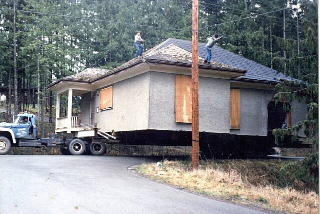 EEks Belton bros moving wires in the old days Vancouver Island